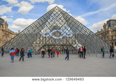 Paris, France - May 12: One of the famous places in Paris the Great Pyramid is the central entrance to the Louvre Museum May 12, 2013 in Paris, France.