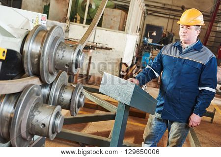 industrial factory worker with tube bending machine