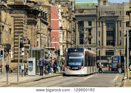 EDINBURGH SCOTLAND - MAY 10 2016: Public transport bus and tram at West End Princess Street station Edinburgh.