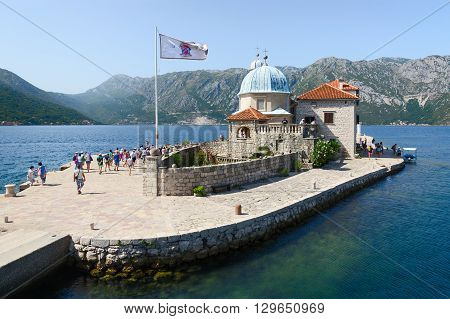 PERAST MONTENEGRO - SEPTEMBER 16 2015: Unidentified tourists visit the Island of Our Lady on the Reef near the town Perast in the Bay of Kotor Montenegro