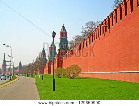 MOSCOW, RUSSIA - APRIL 12 2008: Unidentified people near Kremlin wall in the early morning Moscow Russia. One of the most symbolic constructions in Russia's history can be traced back to the 12th century when Moscow was founded in 1147. The original outpo