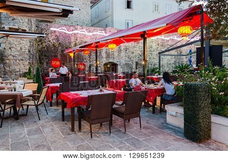 BUDVA MONTENEGRO - SEPTEMBER 18 2015: Unidentified people are relaxing in the evening in the Chinese restaurant Shanghai near the Old town of Budva Montenegro