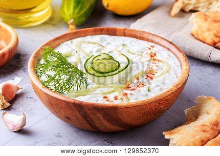 Greek salad tzatziki of cucumber, yogurt, olive oil, garlic, dill and spices, selective focus.