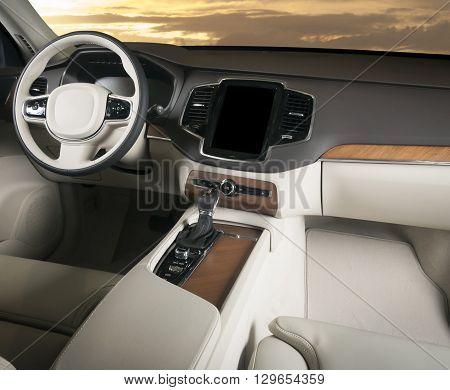 Dark luxury car Interior - steering wheel shift lever and dashboard