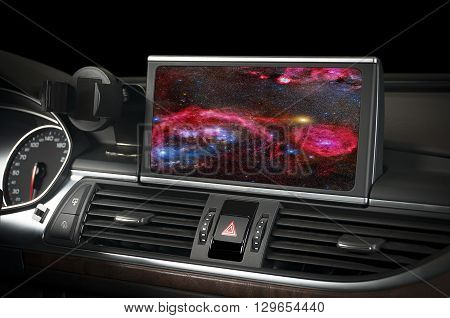 Car interior with space and galaxy on the display and in the windows.