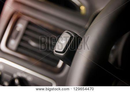 Dark luxury car Interior under steering wheel ok button