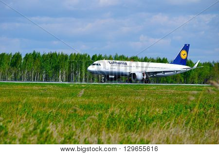 SAINT PETERSBURG RUSSIA - MAY 11 2016. Lufthansa Airbus A320 airplane -registration number D-AIUK- rides on the runway after landing in Pulkovo International airport