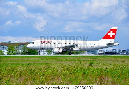 SAINT PETERSBURG RUSSIA - MAY 11 2016. Swiss International Airlines Airbus A320 airplane -registration number HB-JLQ- rides on the runway after arrival in Pulkovo International airport