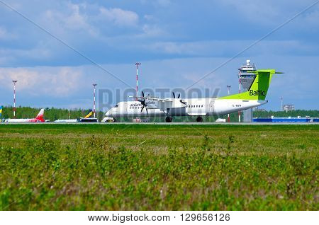 SAINT PETERSBURG RUSSIA - MAY 11 2016. Air Baltic Airlines Bombardier Dash 8 airplane-registration number YL-BBW- is riding on the runway after arrival in Pulkovo International airport