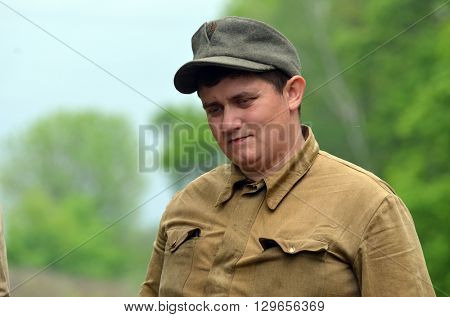 An unidentified person wears historical Ukrainian nazionalist uniform . At May 7,2016 in Kiev, Ukraine