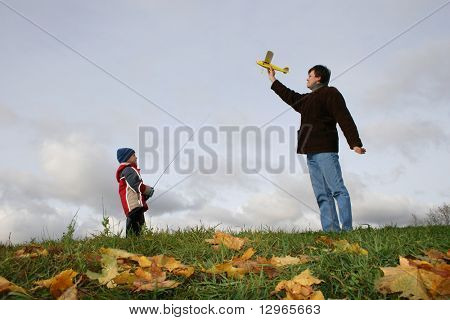 autumn father with son and plane