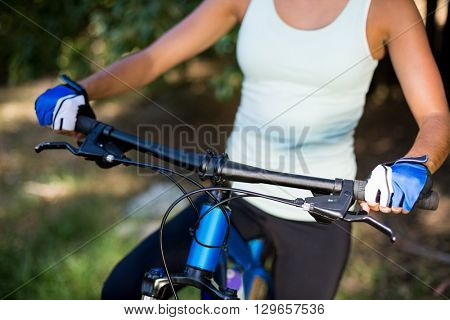 Close up of womans bust on a bike on the wood