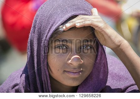 MANALI INDIA - SEPTEMBER 16 2014: Unidentified local young girl outdoor in Manali . The majority of the local population are descendant of Tibetan.