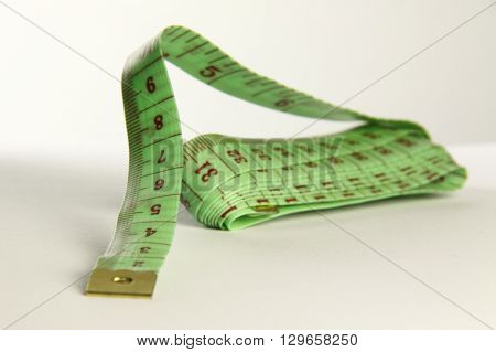 green tape measure for use in most fabric industries and weight loss