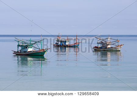 KOH PHANGAN THAILAND - NOVEMBER 16 2015 : Thai fishing boats in the sea. Fishing is main occupation and income source on the island