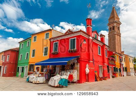 Colorful houses and church on the famous island Burano, Venice, Italy