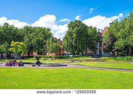 Dublin Ireland - July 30 2013: People in he St Patrik's gardens