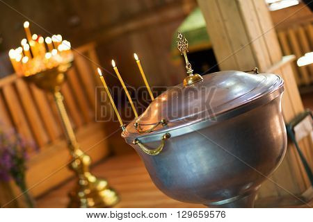 Hot metal and candle in the christian church