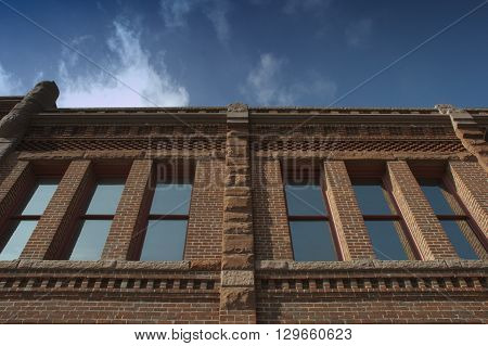 a picture of an exterior 1920's office building
