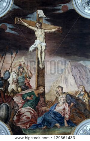 ROSENBERG, GERMANY - MAY 06: Calvary - Jesus dies on the cross, fresco on the ceiling of the Church of Our Lady of Sorrows in Rosenberg, Germany on May 06, 2014.