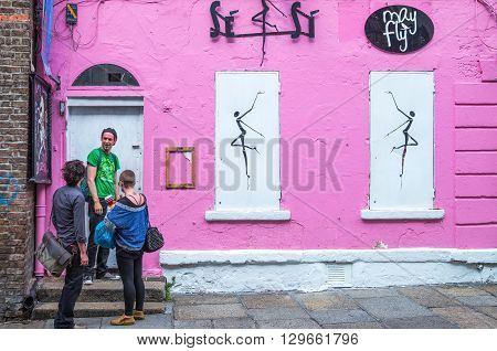Dublin Ireland - July 31 2013: People at the entrance of a shops of the Temple Bar quarter