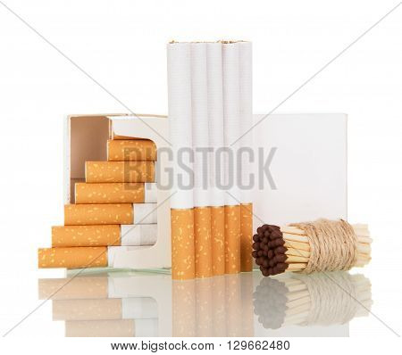 Open pack of cigarettes and a bunch of matches close up isolated on white background