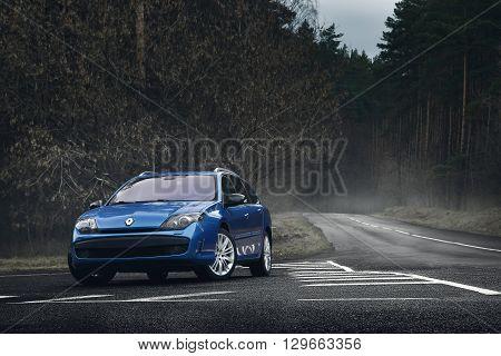 Minsk, Belarus - November 23, 2015: Blue Car Renault Laguna Standing On Asphalt Road At Daytime