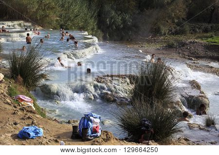 Ocals And Tourists Swim In The Famous Free Hot Springs In Saturnia