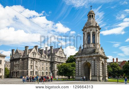 Dublin Ireland - August 3 2013: Visitors under the Campanile of the Trinity College