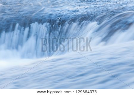 Fast and flowing waterfall background long exposure