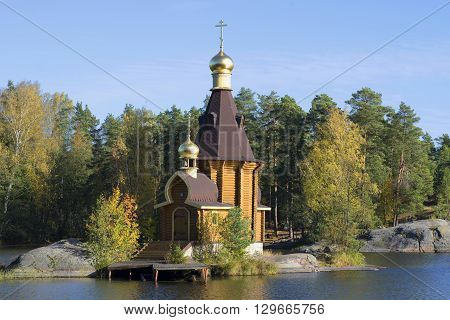 The Church of St Andrew the Apostle on Vuoksi river close-up of golden autumn. Priozersky district, Leningrad region, Russia