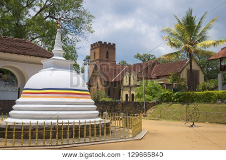 Dagoba in Buddhist complex and the Church of St Paul in the historic centre of Kandy. Sri Lanka