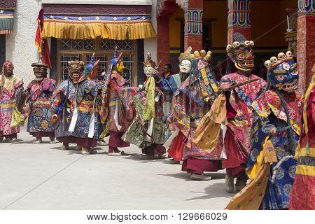 LAMAYURU INDIA - JUNE 13 2015: An unidentified buddhist lamas dressed in mystical mask dancing Tsam mystery dance in time of Yuru Kabgyat Buddhist festival at Lamayuru Gompa Ladakh North India