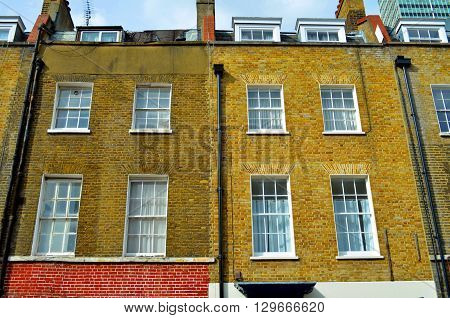 fassade of typical england house in the city of london