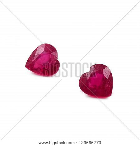 Natural heart shaped rubies on a white background.
