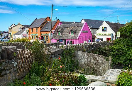 Calway Ireland - August 4 2013: Tourists between the colored houses of the Doolin village