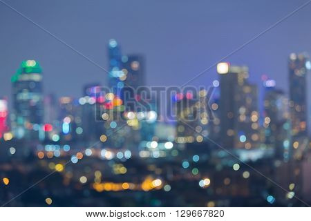 Blurred bokeh lights, aerial view office building downtown, night view