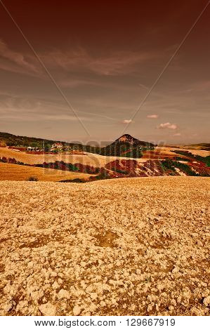 Plowed Sloping Hills of Tuscany in the Autumn at Sunset Vintage Style Toned Picture