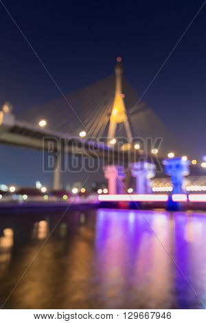 Abstract blurred bokeh lights, suspension bridge and watergate
