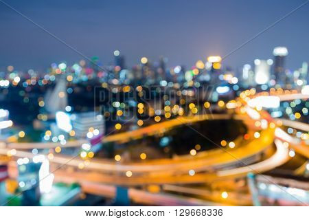 Aerial view, abstract blurred bokeh lights, Highway interchanged and city downtown background