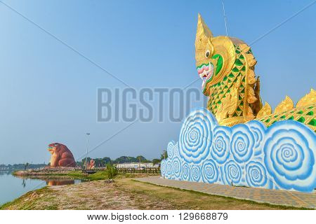 Yasothon Thailand - February 22 2016 : Statue of Naga and Phaya Kan Kark (or Toad King) in Yasothon Thailand.