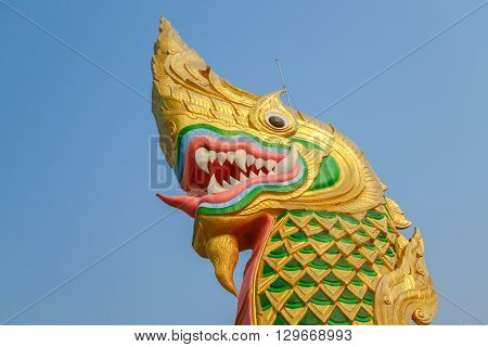 Statue of Naga and blue sky in Yasothon, Thailand