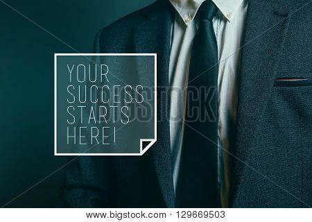 Your success starts here motivational business message with elegantly dressed businessman in background.