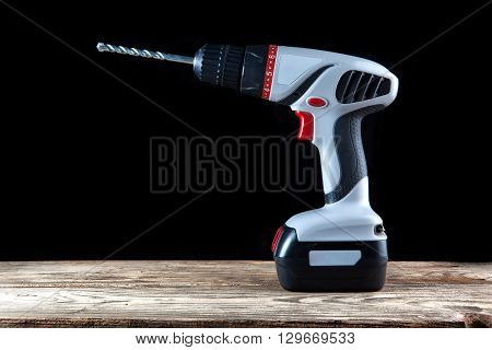 Cordless driver drill  on a dark background