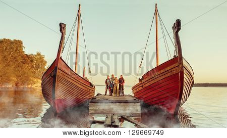 North Prince With The Princess And Two Warriors With Swords On The Sailing Ships Background.