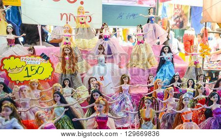 That Phanom Thailand - February 22 2016 : Dolls for sale at market zone of That Phanom's Makhabucha day fair