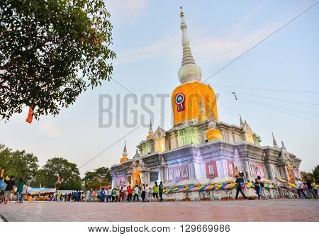 Na Dun Thailand - February 25 2016 : People walk and pray around Phra That Na Dun Temple on Makha Bucha day