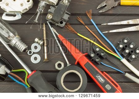 Clutter on the workbench. Tools, electronics repairman. Repair of household electrical equipment. Sales of electronics components. Advertising on servicemen.