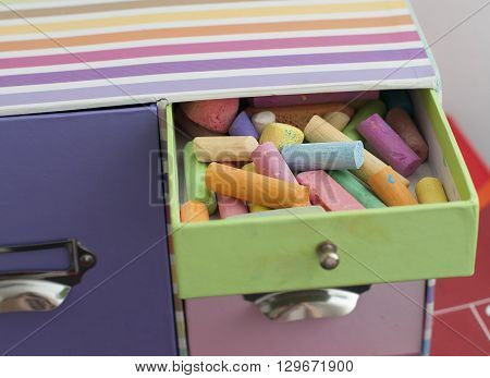 colorful chalk in multicolored box in child's room