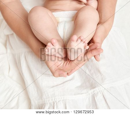 baby feet in mother hand, health care concept, body and skin